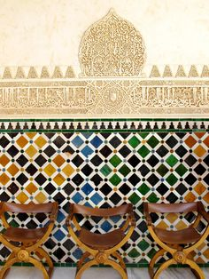 A trio of chairs against a gorgeous wall of colorful tiles and Arabic inscriptions at the Alhambra in Granada, Spain. I strolled through this lavish Moorish palace one hot day in August, and this s… Islamic Architecture, Art And Architecture, Granada Spain, Iron Work, Arabian Nights, Moorish, Islamic Art, Mosaic Tiles, Textures Patterns