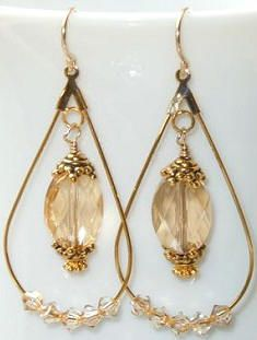 Another popular design on our Idea Page this summer! Swarovski Crystal Golden Shadow Oval #5050 beads in gold teardrop beading hoops.