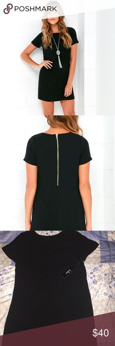 Lulu's SHIFT AND SHOUT BLACK SHIFT DRESS New w/ tag and never worn!  Woven poly fabric shapes a rounded neckline atop a darted bodice with short sleeves. The shift silhouette falls into a flirty, leg-baring length. Exposed gold back zipper.  For dress reviews and more info please visit: https://www.lulus.com/products/shift-and-shout-black-shift-dress/283082.html Lulu's Dresses Midi