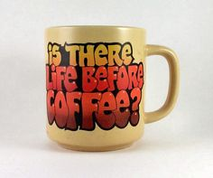 """Retro 1984 Coffee Mug """"Is there life before coffee""""  Made by C. M. Paula Company. Made in Korea.  Cup is yellow with retro colored lettering.  Measures 3 3/4 inches tall and 3 3/4 inches wide.  No chips or cracks seen."""