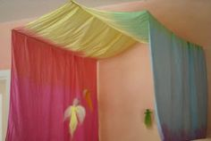 Rainbow canopy over a childs bed - magic