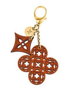 e0670ee6659 Arabesque Bag Charm. Cognac perforated leather Louis Vuitton ...