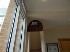 A beautiful hand-carved sign for the Second Story Gallery.