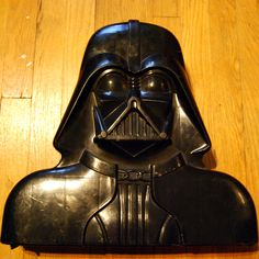 Darth Vader Action Figure Case black, vintage.  I still have mine, although I recently gave it to my son to store all his Star Wars guys in. You know, circle of life and all that.