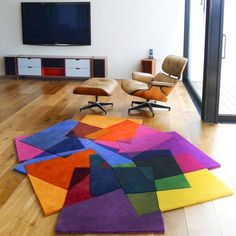 After Matisse Rug by Sonya Winner  Inspired by Matisse's works made of paper cutouts. This irregular shaped rug has a sculptural quality with pile height variations and hand carving. The design is created from a playful collage of overlaying colours. The 26 colours in wool replicate the effect of transparent colours mixing together.