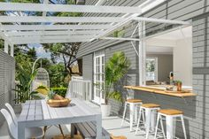 Three Birds Renovations transform an outdoor space. This inviting area features a cut to measure timber ledge available at Bunnings. Decor, House Design, House, Alfresco Designs, Home, Outdoor Rooms, House Exterior, Renovations, Three Birds Renovations
