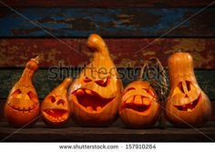 Scary Jack O Lantern Halloween pumpkins in darkness by Wallenrock, via ShutterStock