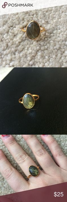 NWOT Semi Precious Stone Ring NWOT semi precious stone ring with gold colored band. Stone is a dark green with hints of grey. Blue Door Boutique Jewelry Rings