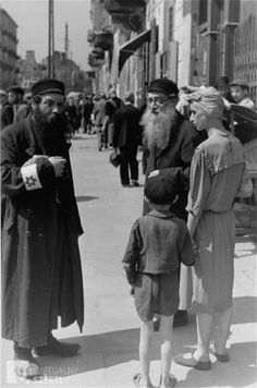 Jews converse on a street in the Warsaw ghetto