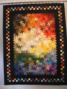 Pinwheels- Scrappy twister quilt, like the color gradation!