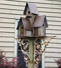 birdhouses on a post with wrought iron gingerbread pieces. This would be a great use of one of our 20 fence posts that will never become a fence #birdhouses on a post with wrought iron gingerbread pieces. This would be a great use of one of our 20 fence posts that will never become a fence.