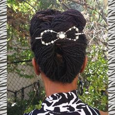 Locs twist secured with a Lilla Rose Flexi Clip. Beautiful and Comfortable!