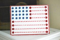 *We R* Eyelet and Twine Flag Card - Scrapbook.com - Fun use for eyelets and twine.