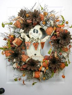 """An impressive sized swag with a 12"""" metallic autumn jack-o'-lantern surrounded by black/orange deco mesh ruffles. Two large """"Terri Bow's"""" with six different ribbons, a """"Happy Halloween"""" sign, and glit"""