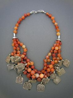 Unique ethnic jewelry and tribal jewelry. Handcrafted necklaces, bracelets, and rings using antique and ancient beads and artifacts by jewelry designer Anna Holland. Metal Necklaces, Metal Jewelry, Jewelry Art, Antique Jewelry, Beaded Jewelry, Silver Jewelry, Jewelry Accessories, Jewelry Design, Antique Silver