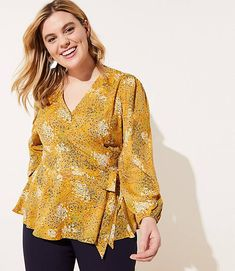 This romantic wrap blouse proves the flattering appeal of a tied waist (with a hint of flair from its hem, too). Long sleeves with puffed shoulders and elasticized cuffs. Plus Size Jeans, Plus Size Blouses, Plus Size Dresses, Plus Size Outfits, Fashion Office, Casual Skirt Outfits, Moda Plus, Wrap Blouse, Plus Size Women