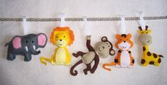 Jungle Animals Nursery Bunting, Jungle Baby Decor, Felt Garland, Animal Baby Shower Decorations  This is such a fun addition to my garland range and one of my favourites. Each little jungle animal measures 11cm tall and has been designed and handsewn by myself using premium 40% wool blend felt.  Includes Elephant, Giraffe, Monkey, Tiger and Lion with hand embroidered facial features. I have given each animal a cute little expression of its own to really add character to this make. The monkey…