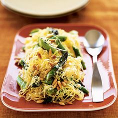 We love this unique recipe that uses a fall favorite: Creamy Spaghetti Squash with Asparagus and Rosemary. #dinner | Health.com