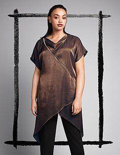 Layered satin tunic with shark-bite hem, contrast gold zipper detail. Soft draped neckline, short sleeves. Metallic copper. lanebryant.com
