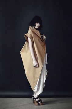 Three dimensional fashion design, garment construction, sculptural style, muted colours
