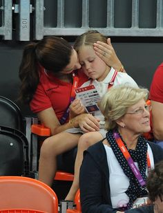 Crown Princess Mary of Denmark being a mummy with Princess Isabella at the Olympics 2012