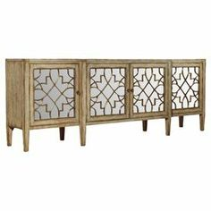 "4-door mirrored console with a fretwork motif.     Product: Console    Construction Material: Hardwood solids, oak veneers and mirrored glass     Color: Natural   Features:   Distressed finish   Four doors   Fretwork motif    Dimensions: 38"" H x 105"" W x 20"" D"