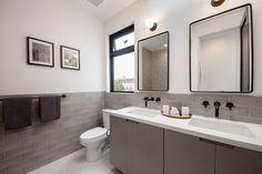 Grey subway tile creates a subdued, timeless bathroom.