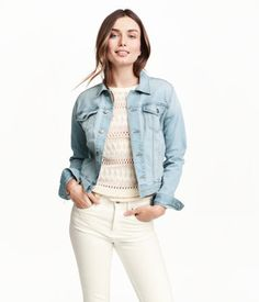 Straight-cut denim jacket in washed, stretch denim with worn details, chest flap pockets with a button, side pockets, adjustable tabs at the sides and buttons down the front and at the cuffs.