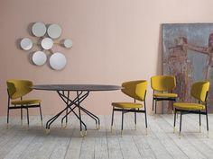 Achim Rotundă, masă de restaurant cu un design modern, având baza din metal și blatul din porțelan. Forma frumoasă a bazei oferă un aspect interesant mesei, dar și un suport stabil pentru blat. Disponibilă în nuanțe de negru mat și negru cărbune. Pentru un plus de eleganță, picioarele mesei sunt vopsite la bază în nuanță aurie. Minimalism, Dining Table, Mirror, Modern, Furniture, Design, Home Decor, Trendy Tree, Decoration Home