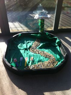 Jack and the beanstalk tuff tray. Used mixed beans and glass beads to make the path.