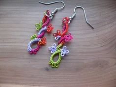 Tatting Box calls these Lizard Earrings. I love them as lizards or just abstract shapes, like this one with an extra turn (https://www.facebook.com/photo.php?fbid=422436914492441=pb.381293655273434.-2207520000.1375836270.=3=https%3A%2F%2Ffbcdn-sphotos-c-a.akamaihd.net%2Fhphotos-ak-ash4%2F740405_422436914492441_1218471802_o.jpg=https%3A%2F%2Ffbcdn-sphotos-c-a.akamaihd.net%2Fhphotos-ak-prn1%2F64945_422436914492441_1218471802_n.jpg=2048%2C1536)