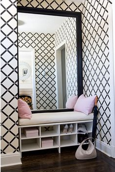 The drama of that stunning over-the-top entryway in the large scale bold black and white pattern is fantastic.