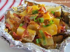 Ingredients: 4 medium potatoes, cut into 1-inch cubes 4 tbsp. butter 2 cups shredded cheddar cheese 1 cup cooked & crumbled bacon 2 green onions, sliced salt & pepper to taste