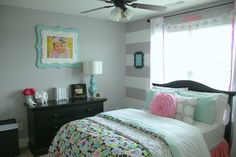 Floral, Girly Big Girl Room - love the mix of striped wall and floral bedding