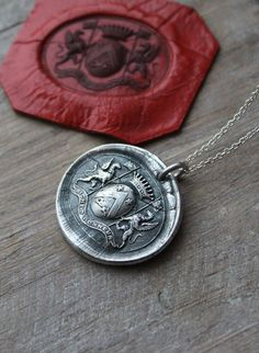 Gryphon-Griffin-rich of honor wax seal impression fine silver pendant by ALMrozarka on Etsy Mens Silver Necklace, Sterling Silver Necklaces, Silver Jewelry, Jewelry Shop, Handmade Jewelry, Handmade Silver, Antique Wax, Leaf Jewelry, Jewellery