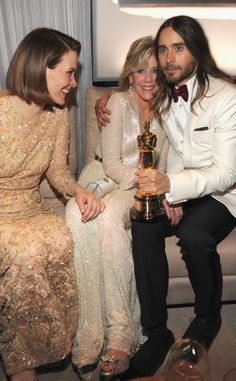 Sarah Paulson and Jane Fonda with her hand on Jared Leto's inner thigh. Can't blame her. The Oscars 2014 Vanity Fair Party.