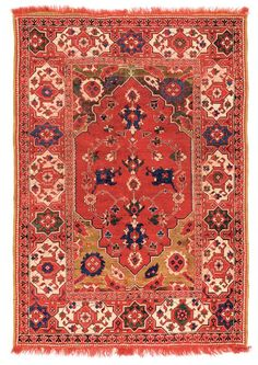 Transylvanian rug with Star-and-cartouche border : Lot 34