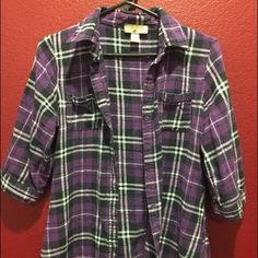 Purple plaid/flannel. Super comfy! It's purple plaid, two pockets in the front and button up! Sleeves go to the elbow! Sugar Cookie Tops Button Down Shirts