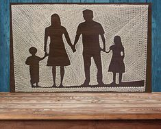 Family Silhouettes String Art This made to order silhouettes of parents with children string art will be a beautiful statement piece in any room of your home. Perfect gift for anniversary or housewarming. A totally customizable family silhouettes string art. Dimensions: Width: 80 cm