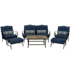 Oceana 6-Piece Patio Set in Navy Blue with a Stone-top Coffee Table. 6-piece patio set from Hanover's Oceana Collection. Set includes one loveseat, two arm chairs, two ottomans, four accent pillows and one coffee table. Durable wrought-iron and steel frames in matte black. Cushion color: Navy Blue. Accent pillow: Navy Kaleidoscope.