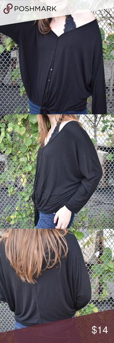 Tie Front Cable & Gauge Top Adorable solid black tie front top with a v-neck cut and button down fit. Super cute tie in the front and 3/4 length sleeves. Model is a size 4 for reference. Great condition, no flaws found. Cable & Gauge Tops Blouses