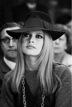 Brigitte Bardot, 1960s. Hat + long chain over a jersey.