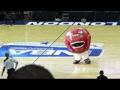 Toronto Raptors mascot eating cheerleader