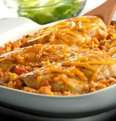 Recipe for Tex Mex Chicken and Rice Bake - Just pop it in the oven, and in less than an hour, you'll have a cheesy, family-friendly dish.