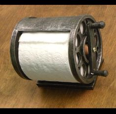 Fishing reel toilet paper holder by SouthernStyleIt