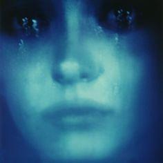 Polaroid photo of a woman's face with tears.