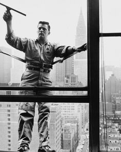 A window cleaner working at high altitude in New York City,