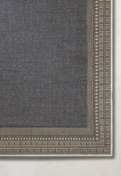 Our Harper Indoor/Outdoor Rug features a unique twist on a sophisticated border. The flat-weave design gives the rug a nice hue and subtle sheen that works well in any outdoor setting. This easy-care rug is powerloomed using polypropylene to retain its colors and design season after season.