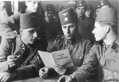 "Soldiers of the 13th Waffen Mountain Division of the SS Handschar with a brochure about ""Islam and Judaism"", 1943. The ""Handschar division "" where Composed of Bosnian Muslims (ethnic Bosniaks) with some Catholic Croat soldiers and mostly German and Yugoslav Volksdeutsche (ethnic German) officers and non-commissioned officers, it took an oath of allegiance to both Adolf Hitler and the Croatian leader Ante Pavelić"