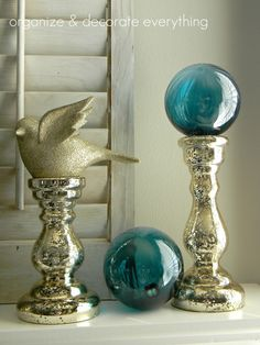 SO hard for me to decorate after Christmas, here's a thought. I out a blue Japanese float on mercury candle post, like one on left.